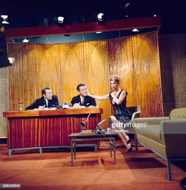 American entertainer Gypsy Rose Lee appears with David Frost and chat show host Eamonn Andrews on the set of the television series 'The Eamonn...