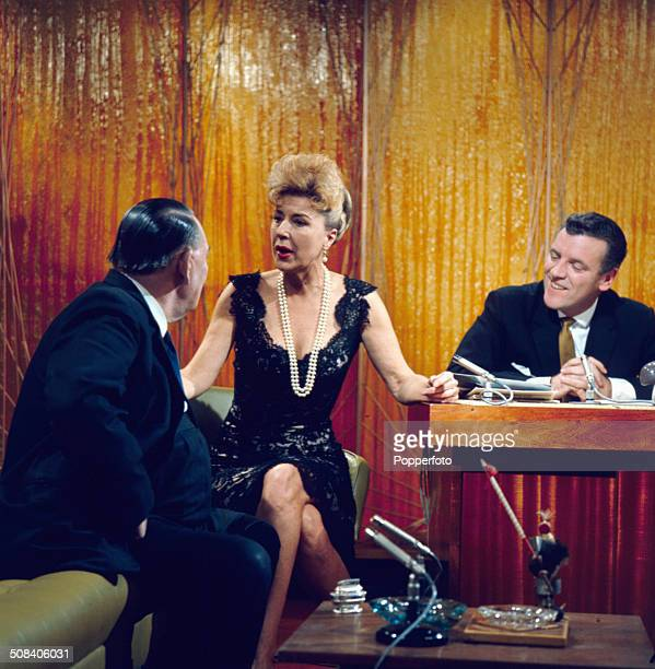 American entertainer Gypsy Rose Lee appears with trade unionist Ted Hill and chat show host Eamonn Andrews on the set of the television series 'The...