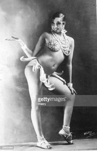 American entertainer Josephine Baker , in costume for her famous 'banana dance'. Baker was an overnight sensation when she arrived in Paris in the...