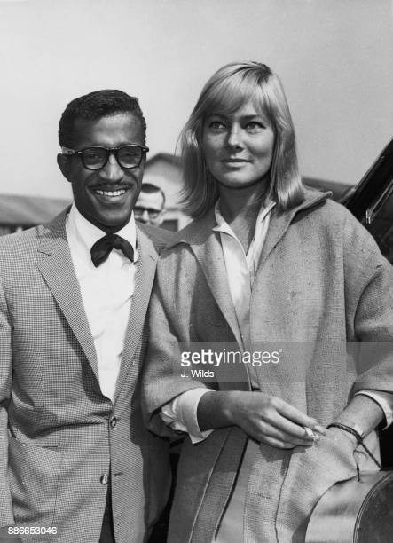 American entertainer Sammy Davis Jr meets his future wife Swedish actress May Britt on her arrival at London Airport from Hollywood 4th June 1960