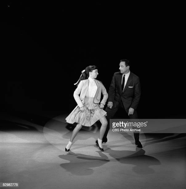 American entertainers Liza Minnelli and Gene Kelly dance together on a television special called 'The Gene Kelly Show' April 24 1959 Kelly is dressed...