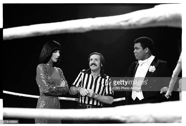 American entertainers singer and actress Cher singer actor and politician Sonnny Bono and heavyweight boxer Muhammad Ali stand and talk in a boxing...
