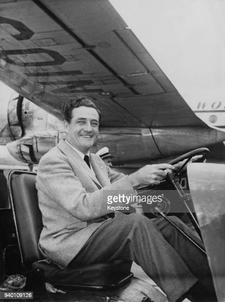 American entrepreneur Briggs Cunningham drives a luggage cart at Orly Airport near Paris France having arrived to take part in the 24 Hours of Le...