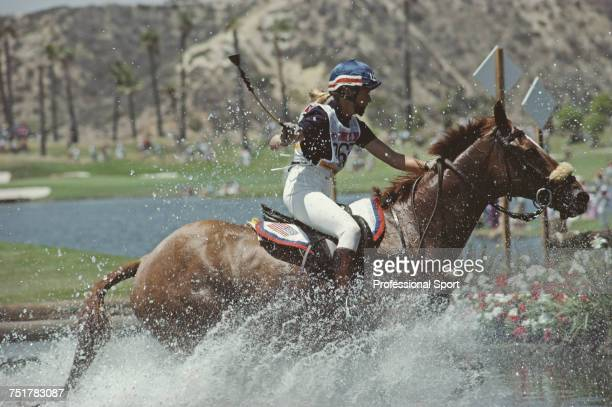 American equestrian Torrance Fleischmann pictured in action for the United States team on her horse 'Finvarra' at the water hazard during competition...