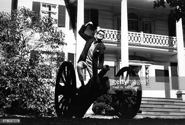 American essayist and literary critic Seymour Krim poses atop a cannon at the MorrisJumel Mansion New York New York October 12 1960 The photo was...
