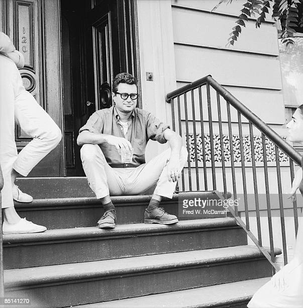 American essayist and literary critic Seymour Krim sits on the stoop of his East Village home New York New York September 1959