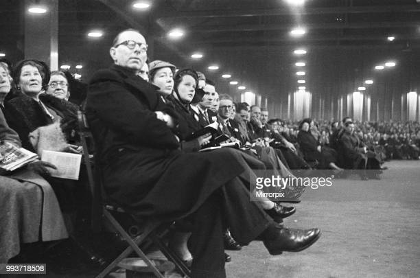 American evangelist Billy Graham addressing a huge crowd of people at Kelvin Hall in Glasgow Scotland during his Scottish Crusade 23rd March 1955