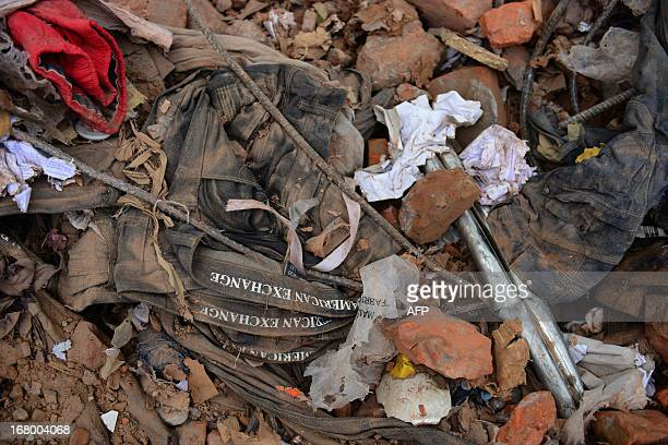 American Exchange Ltd. Clothing tags are seen amongst the rubble at the site of the eight-storey building collapse in Savar, on the outskirts of...