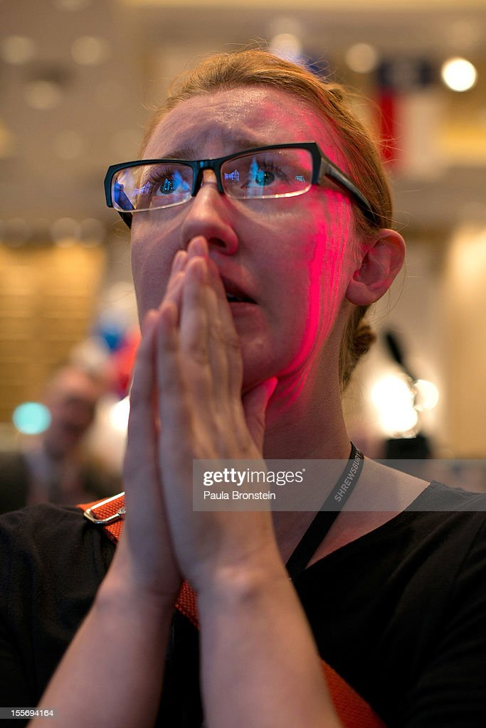 American expat Mary Conger from Minnesota reacts as President Barak Obama fights to win his re-election bid at the U.S embassy election watch party November 7, 2012 in Bangkok, Thailand. Obama won with 303 electoral votes to Romney's 206 with Florida votes still not included in the total.