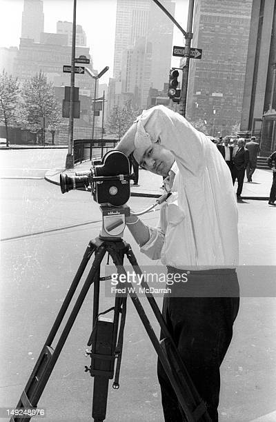 American experimental filmmaker Ken Jacobs lines up a shot with his camera near the Manhattan Municipal Building New York New York May 29 1966 The...