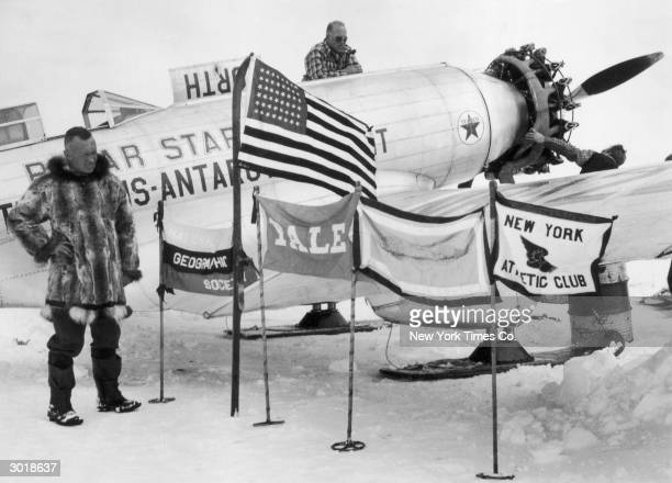 American explorer Lincoln Ellsworth with the flags of the USA the National Geographic Society Yale University the Quiet Birdmen aviation club and the...
