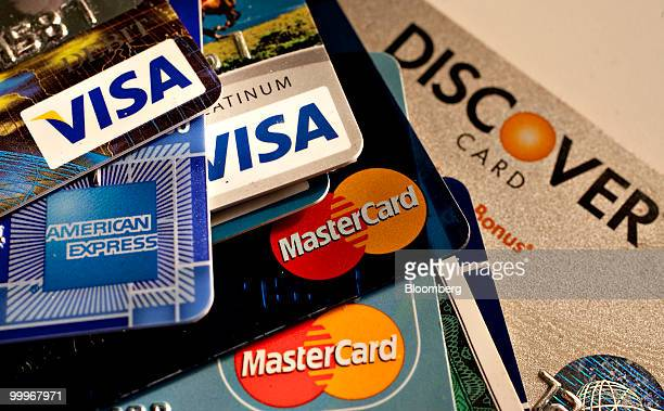 American Express, Discover, MasterCard and Visa credit cards are displayed for a photograph in New York, U.S., on Tuesday, May 18, 2010. Credit-card...