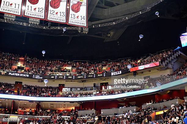American Express Surprises Miami HEAT fans with Shop Small gifts delivered from parachutes> at American Airlines Arena on November 10 2016 in Miami...