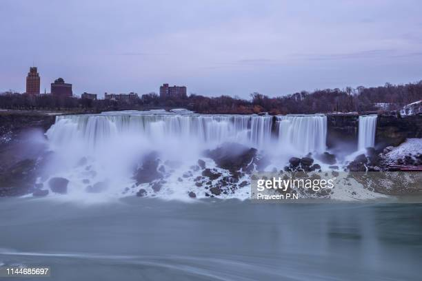 american falls on a gloomy day - niagara river stock pictures, royalty-free photos & images