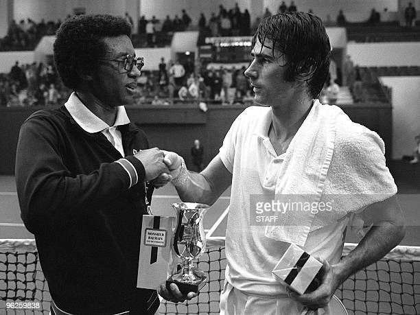 American famous tennis player Arthur Ashe shakes hand with his compatriot Martin Riessen after beaten him in the Open of Paris finals 16 November...
