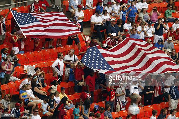 American fans unfurl the Stars and Stripes during the 2003 FIFA Women's World Cup first round Group A game against Sweden at RFK Stadium on September...