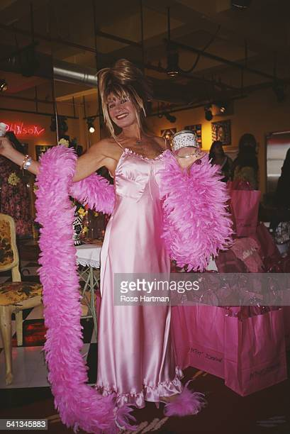 American fashion designer Betsey Johnson holds up new items for sale at a product launch held at the B Johnson showroom New York 2000