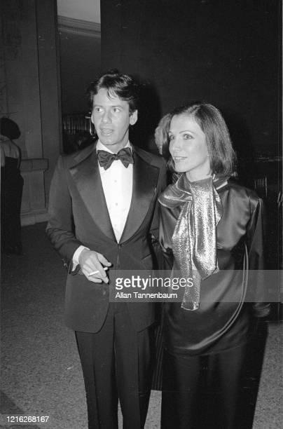American Fashion designer Calvin Klein and his assistant Kelly Rector attend the Glory of Russian Costume Exhibition held in the Metropolitan Museum...