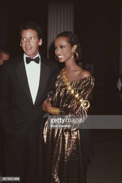 American fashion designer Calvin Klein and Somali fashion model Iman at the Met Gala Metropolitan Museum of Art New York City USA December 1981