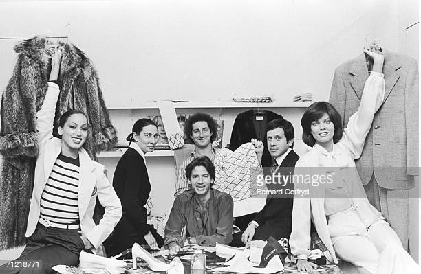 American fashion designer Calvin Klein surrounded by models and staff members in his design studio New York New York early 1970s