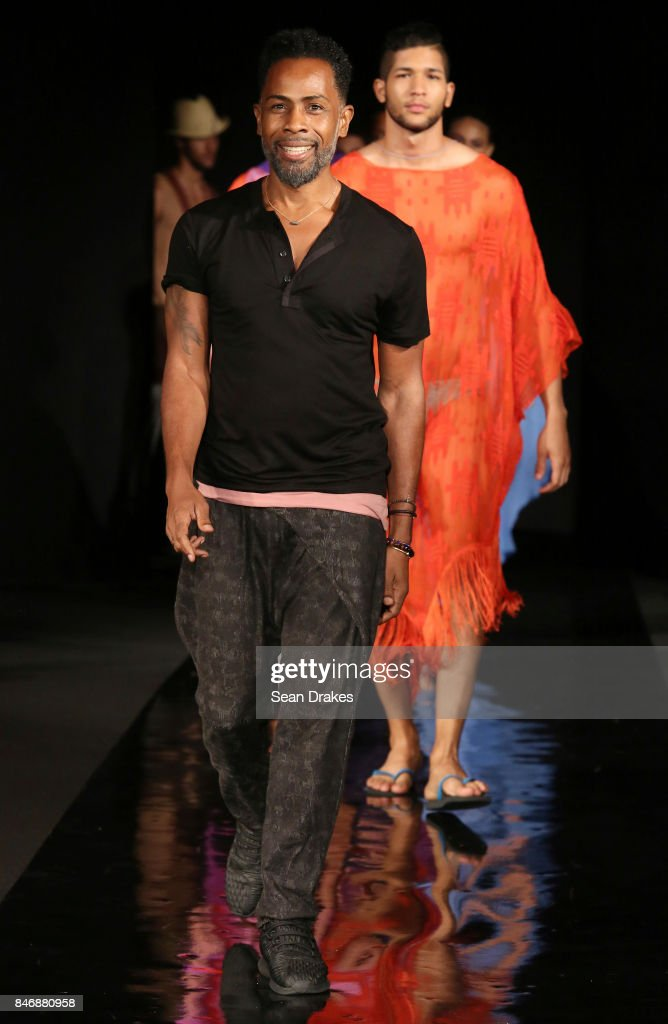American fashion designer Carlton Jones poses with models in the Fashion Designers of Latin America collection shows during New York Fashion Week at Skyline Hotel on September 13, 2017 in New York City.