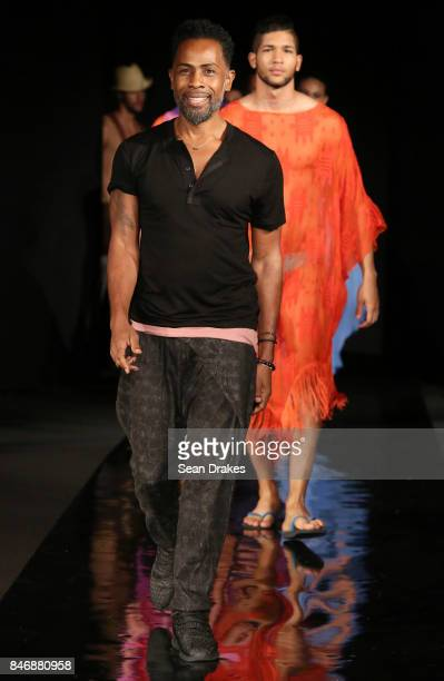 American fashion designer Carlton Jones poses with models in the Fashion Designers of Latin America collection shows during New York Fashion Week at...