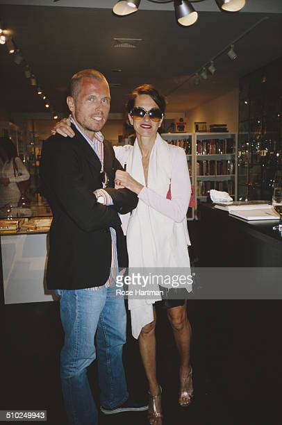 American fashion designer, Cynthia Rowley and her husband, gallery owner and writer, Bill Powers, at an art gallery in East Hampton, New York, USA,...