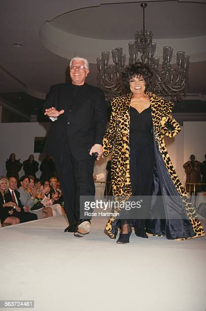 American fashion designer Dennis Basso and American actress and singer Eartha Kitt on the runway at Basso's fashion show circa 1997