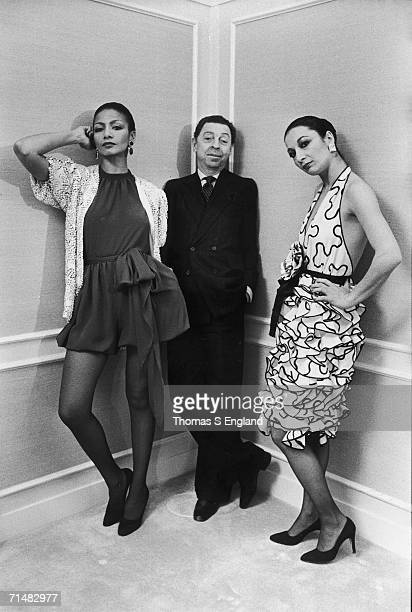 American fashion designer James Galanos leans in a corner at a Saks Fifth Avenue department store, his hands in the pockets of his double-breasted...