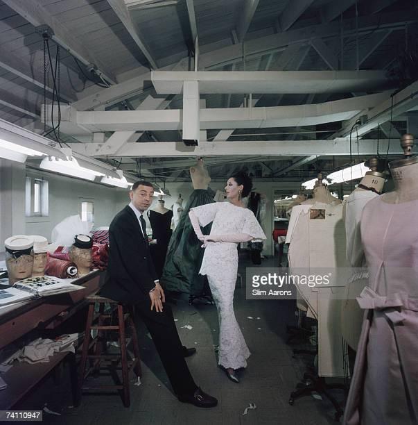American fashion designer James Galanos with supermodel Dovima in his studio 1960