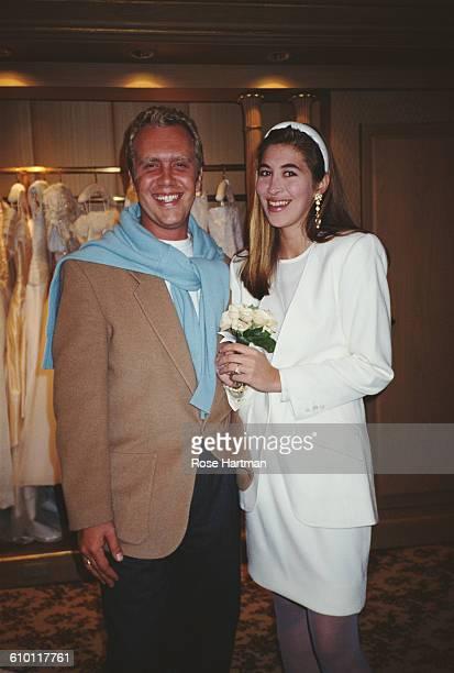 American fashion designer Michael Kors with a model in bridalwear, USA, 1991.