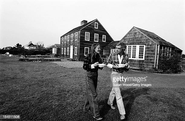 American fashion designer Ralph Lauren and his wife therapist Ricky Lauren walk outside their home East Hampton New York November 1977