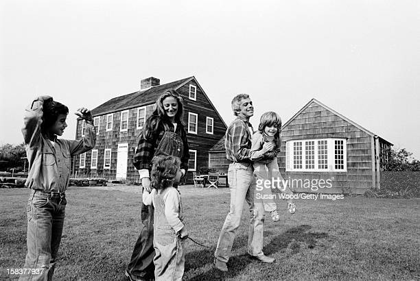 American fashion designer Ralph Lauren and his wife, therapist Ricky Lauren, walk outside their home, with their children Andrew, Dylan and David,...