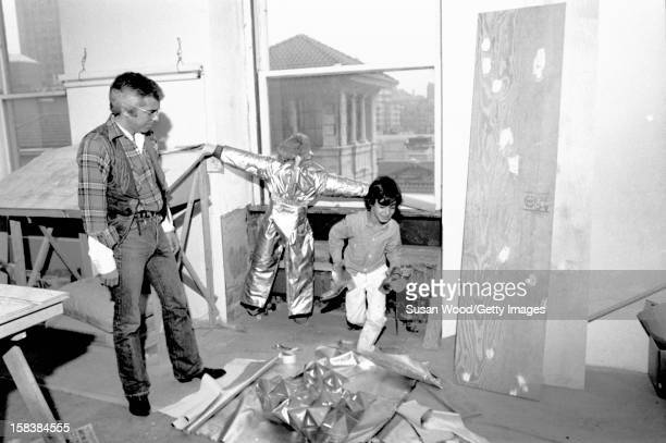 American fashion designer Ralph Lauren and one of his sons in their 5th Avenue apartment during renovations New York New York November 1977