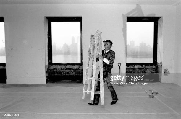 American fashion designer Ralph Lauren carries a ladder in his 5th Avenue apartment during renovations New York New York November 1977
