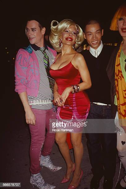 American fashion designer Richie Rich American model and socialite Amanda Lepore and Chinese model Jeffrey Zheng Yu Guang circa 2002