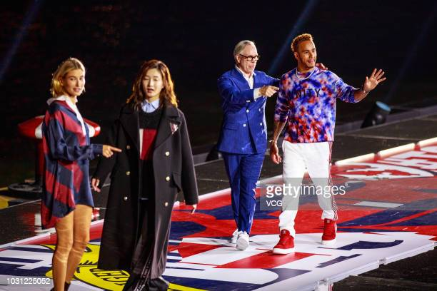 American fashion designer Tommy Hilfiger of Tommy Hilfiger Corporation British racing driver Lewis Hamilton and model Hailey Baldwin walk the runway...