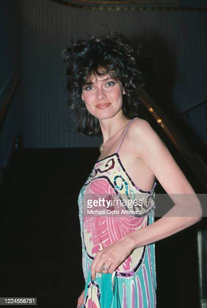 American fashion model and actress Carol Alt wearing a patterned spaghetti strap dress at an unspecified event, circa 1985.