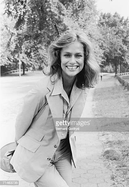 American fashion model and actress Lauren Hutton poses for photographs with her hands behind her back in Central Park New York 1970s