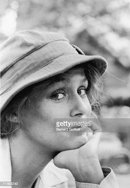 American fashion model and actress Lauren Hutton poses for photographs with her head on her hand in Central Park New York 1970s
