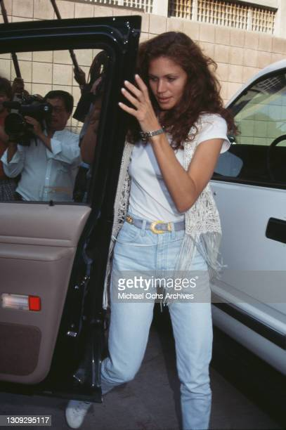 American fashion model and actress Paula Barbieri, wearing a crochet waistcoat, a white t-shirt and stonewashed denim jeans, location unspecified,...