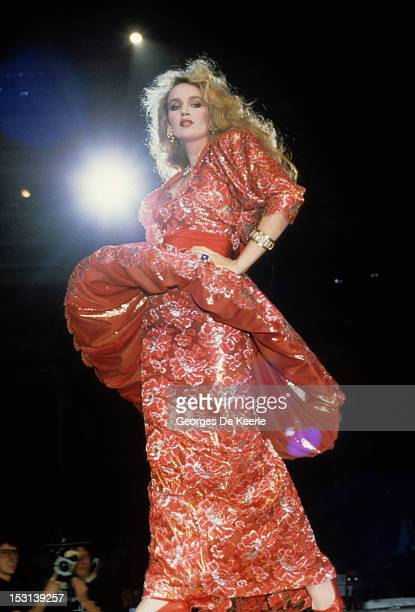American fashion model Jerry Hall on the catwalk during the Fashion Aid show in aid of African famine relief, UK, 5th November 1985.
