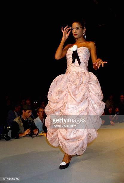 American fashion model Veronica Webb wears a pink readytowear ruffled evening gown by French design house Chanel at the 1988 SpringSummer fashion...