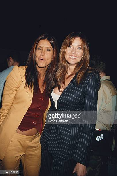 American fashion models Janice Dickinson and Carol Alt at the Tommy Hilfiger Men's and Women's Spring 2003 fashion show New York City 18th September...