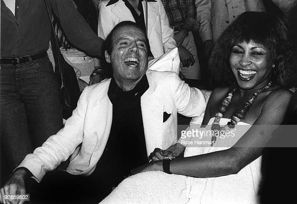 American fashion photographer Francesco Scavullo shares a laugh with singer Tina Turner while partying at Studio 54 New York 1977