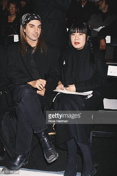 American fashion photographer Steven Meisel and fashion designer Anna Sui attend the Marc Jacobs Fall 1999 collection fashion show New York City 1999