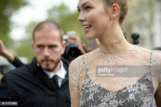 American fashion Supermodel Karlie Kloss fans stop traffic as she departs the Christian Dior Collection Show for Paris Fashion Week Spring/Summer...