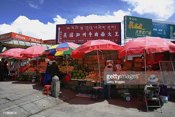 American fast food restaurants and stalls open at the Jokhang Temple Square which is the sacred Buddhist center for pilgrims of the Tibet on June 26...