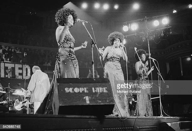 American female backing vocal trio Love Unlimited performing with American composer and singersongwriter Barry White and The Love Unlimited Orchestra...