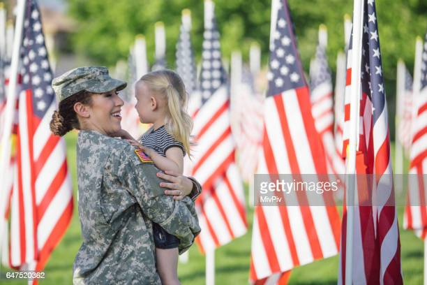 American female soldier with 3 year old girl